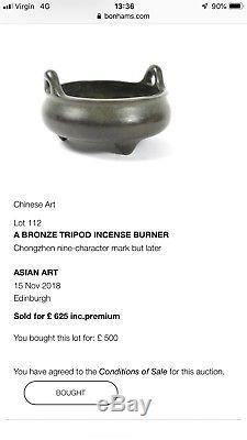 A Chinese bronze tripod incense burner