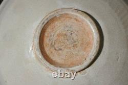 Two Chinese Yuan Qingbai Bowls one with molded lotus decoration 13th C